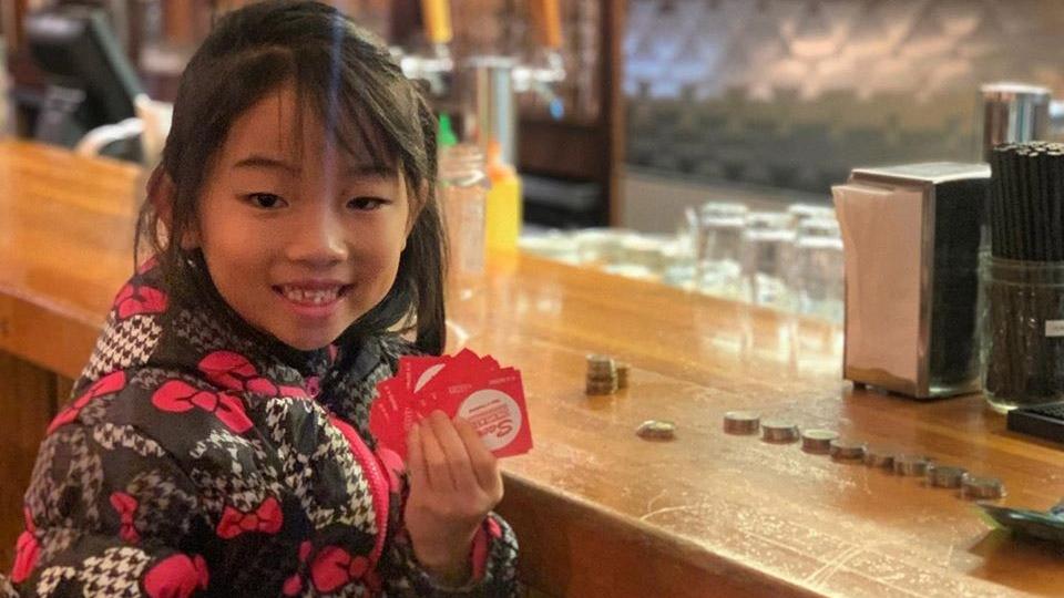 Girl uses lemonade stand, garage sale money to buy food for the homeless