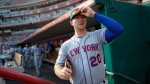 New York Mets first baseman Pete Alonso prepares to take the field in the fourth inning of a baseball game against the Cincinnati Reds, Saturday, Sept. 21, 2019, in Cincinnati. (AP Photo/John Minchillo)