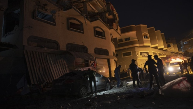 Palestinians check the damage of a house targeted by Israeli missile strikes in Gaza City, Tuesday, Nov. 12, 2019. (AP Photo/Khalil Hamra)