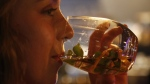 Elsabe Hanekom takes part in a gin tasting session at the Botlierskop Private Game Reserve, near Mossel Bay, South Africa, Monday, Oct. 23, 2019. (AP Photo/Denis Farrell)