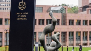 FILE - In this Oct. 5, 2015 file photo, a man walks by the European Court of Justice in Luxembourg. (AP Photo/Geert Vanden Wijngaert, FILE)