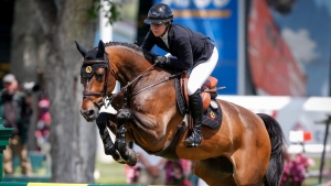 Canada's Nicole Walker rides Falco van Spieveld, during the Grand Prix event of the National at Spruce Meadows in Calgary, Saturday, June 8, 2019. THE CANADIAN PRESS/Jeff McIntosh