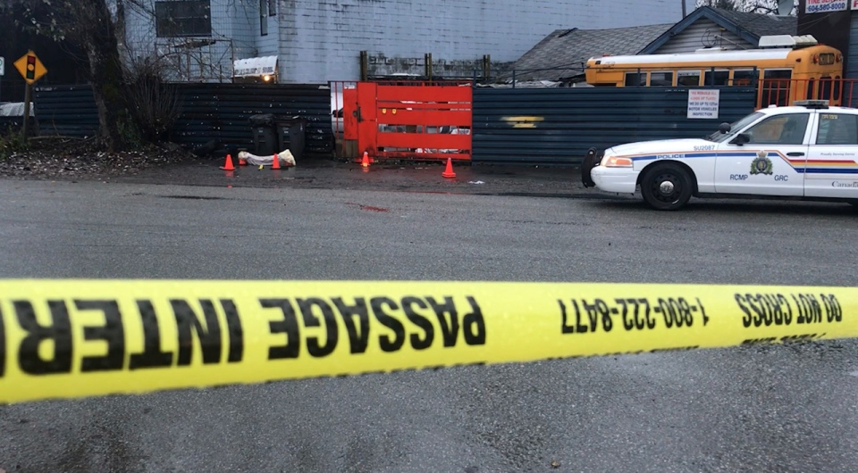 Police tape blocks the scene of a death in Surrey early Tuesday, Nov. 12, 2019. (Sheila Scott / CTV News Vancouver)