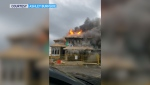 Two homes were destroyed in the fire that authorities say started inside a home under construction.