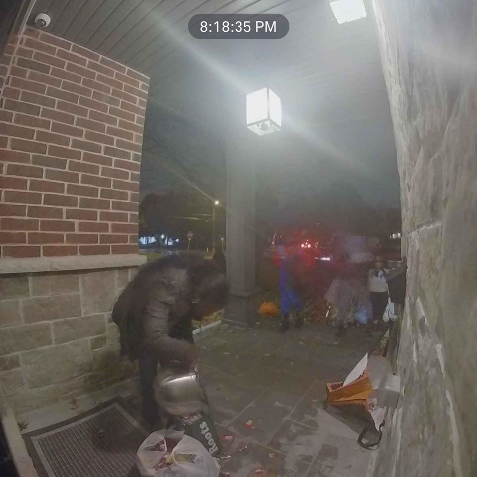 This is the security image that Tami Zuckerman-Mercier believes shows a woman stealing all of the candy she had set out for trick-or-treaters. (Tami Zuckerman-Mercier / Facebook)