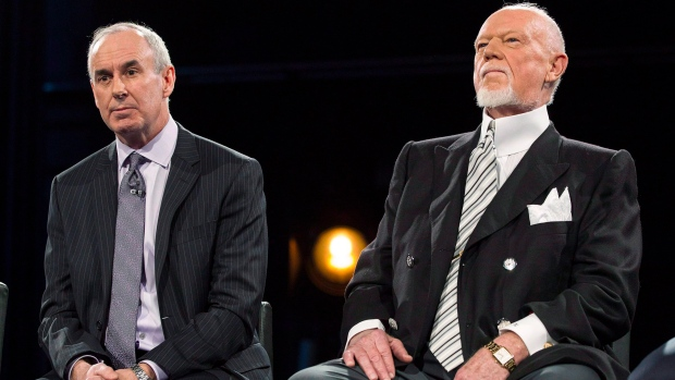 Ron MacLean (left) sits with Don Cherry as Rogers TV unveils their team for the station's NHL coverage in Toronto on Monday, March 10, 2014. THE CANADIAN PRESS/Chris Young