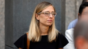 In this July 15, 2019 file photo, Annie Farmer, one of Jeffrey Epstein's accusers who spoke at his bail hearing, attends a news conference outside federal court in New York. (AP Photo/Richard Drew, File)