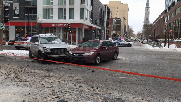 Cars collided on Rene-Levesque Blvd. on Tuesday as an SUV shielded a group of pedestrians from a car fleeing Montreal police.