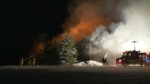 Fire crews are seen here battling a major barn fire near Drayton. (Terry Kelly / CTV Kitchener)