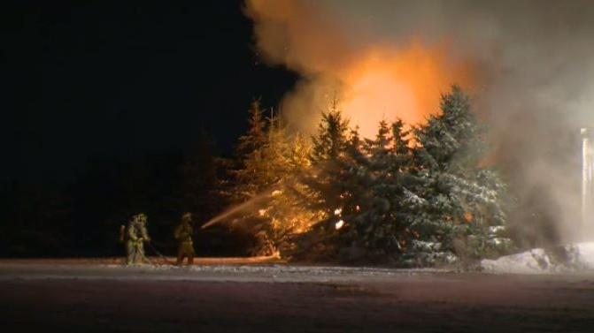 Crews battle barn fire near Drayton