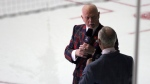 Canadian television presenters Don Cherry, left, and Ron MacLean are seen during a live broadcast in the first intermission of NHL preseason action at the Q Centre in Victoria, B.C., on September 21, 2015. THE CANADIAN PRESS/Chad Hipolito