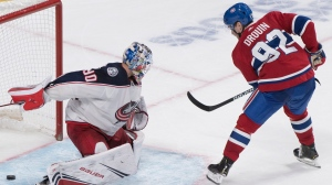 Montreal Canadiens' Jonathan Drouin scores against Columbus Blue Jackets goaltender Elvis Merzlikins during shootout NHL hockey action in Montreal, Tuesday, Nov. 12, 2019. THE CANADIAN PRESS/Graham Hughes
