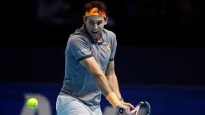 Austria's Dominic Thiem plays a return to Serbia's Novak Djokovic during their ATP World Tour Finals singles tennis match at the O2 Arena in London, Tuesday, Nov. 12, 2019. (AP Photo/Alastair Grant)