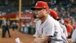FILE - In this Sept. 25, 2019, file photo, St. Louis Cardinals manager Mike Shildt pauses in the dugout during the fifth inning of the team's baseball game against the Arizona Diamondbacks in Phoenix. (AP Photo/Ross D. Franklin, File)