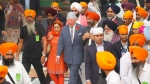 Britain's Prince Charles, center, visits Gurudwara Bangla Sahib, a Sikh Temple in New Delhi, India, Wednesday, Nov. 13, 2019.  (AP Photo/Manish Swarup)