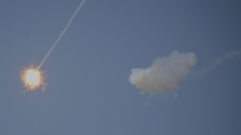 An Israeli Iron Dome air defense system missile is seen intercepting rockets fired from Gaza over Sderot, southern Israel, Wednesday, Nov. 13, 2019. (AP Photo/Ariel Schalit)