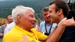 FILE - In this July 19 2017 file photo, French President Emmanuel Macron speaks with former French cyclist ace Raymond Poulidor, in Saint-Martin-d'Arc, after the e 104th edition of the Tour de France cycling race between Le La Mure and Serre-Chevalier, French Alps. (Jean-Pierre Clatot, Pool via AP)