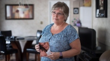 Wendy Gould holds a photograph of her late husband George Gould at her home, in Aldergrove, B.C., on May 25, 2018. DARRYL DYCK/THE CANADIAN PRESS
