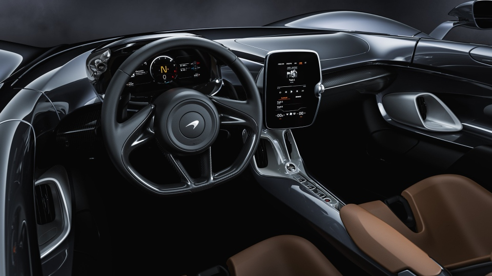 Controls for different drive modes, including Sport, Comfort and Track, are on the steering wheel. (McLaren)