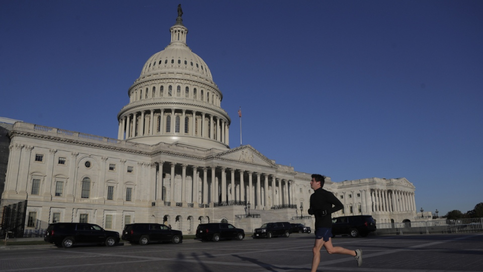 A jogger runs past the U.S. Capitol