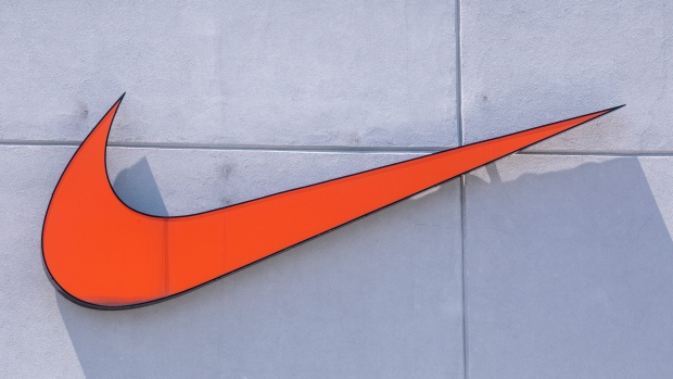 A Nike sign is seen on a store front in Montreal on Tuesday, June 18, 2019. (THE CANADIAN PRESS/Paul Chiasson)