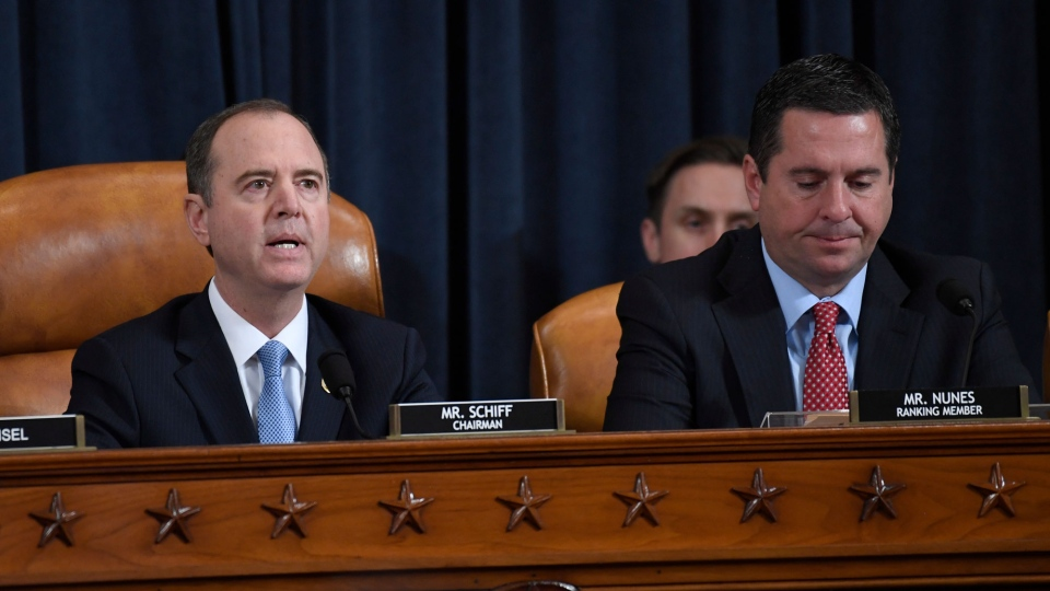 House Intelligence Committee Chairman Rep. Adam Schiff, D-Calif., left, and ranking member Rep. Devin Nunes, R-Calif., look on during a hearing of the House Intelligence Committee on Capitol Hill in Washington, Wednesday, Nov. 13, 2019, during the first public impeachment hearing of President Donald Trump's efforts to tie U.S. aid for Ukraine to investigations of his political opponents. (AP Photo/Alex Brandon)