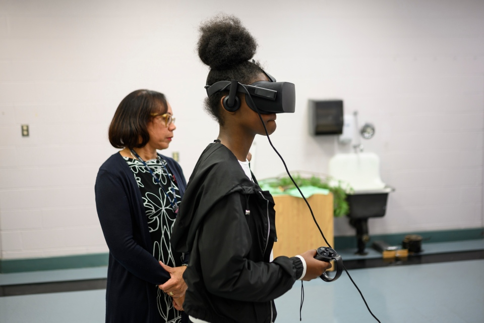 Nyisha Clayton, right, a Grade 10 student at Auburn Drive High School, and principal Karen Hudson experience the virtual-reality project on Wednesday, November 6, 2019. THE CANADIAN PRESS/Darren Calabrese
