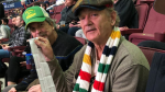 Actor Bill Murray holds up 50/50 tickets at the Vancouver Canucks game on Tuesday, Nov. 12, 2019.