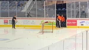 Brandt Centre ice crews are seen cleaning up a spill that caused the cancellation of a game between the Regina Pats and Swift Current Broncos on Nov. 8, 2019. (Marc Smith/CTV News Regina)