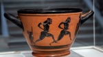 An ancient Greek drinking cup decorated with runners, which was one of the awards presented to Spyros Louis, the Greek winner of the Marathon in the 1896 first modern Olympic Games in Athens, is seen at the National Archaeological Museum in Athens on Wednesday, Nov. 13, 2019. (AP Photo/Petros Giannakouris)