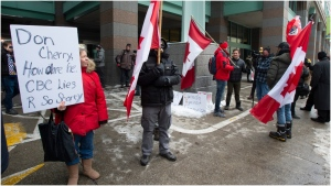Don Cherry supporters stand outside Rogers head office in Toronto on Wednesday November 13, 2019. THE CANADIAN PRESS/Frank Gunn