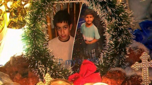 Jonathan and Nicolas Bastidas are seen in these images placed at a memorial outside their home.