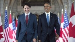 U.S. President Barack Obama and Prime Minister Justin Trudeau walk down the Hall of Honour on Parliament Hill, in Ottawa, June 29, 2016. THE CANADIAN PRESS/Paul Chiasson