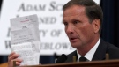 Rep. Chris Stewart, R-Utah, holds up the transcript summary of the call between President Donald Trump and Ukraine President Volodymyr Zelenskiy as he questions top U.S. diplomat in Ukraine William Taylor, and career Foreign Service officer George Kent, at the House Intelligence Committee hearing on Capitol Hill in Washington, Wednesday, Nov. 13, 2019. (AP Photo/Susan Walsh)