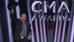 Garth Brooks accepts the award for entertainer of the year at the 53rd annual CMA Awards at Bridgestone Arena, Wednesday, Nov. 13, 2019, in Nashville, Tenn. (AP Photo/Mark J. Terrill)