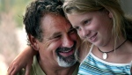 In a June 2003 photo, St. Paul Saints co-owner Mike Veeck poses with daughter Rebecca, 11, at his home in Charleston, S.C. (Judy Griesedieck/Star Tribune via AP)