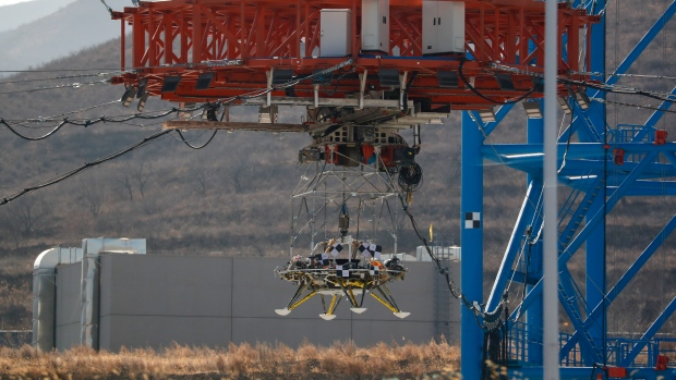 A lander is lifted from the ground during a test of hovering, obstacle avoidance and deceleration capabilities at a facility in Huailai in China's Hebei province, Thursday, Nov. 14, 2019. (AP Photo/Andy Wong)
