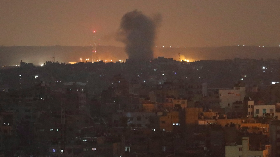 An explosion caused by Israeli airstrikes is seen in Gaza City, early Thursday, Nov. 14, 2019. (AP Photo/Adel Hana)