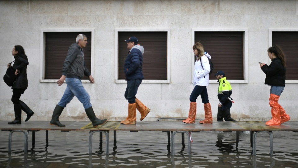 Officials erected a footbridge across flooded streets in Venice after the tide hit. (AFP)