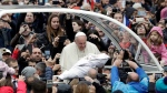 Pope Francis is given a newborn baby to bless as he arrives for his weekly general audience in St. Peter's Square, at the Vatican, Wednesday, Nov. 13, 2019. (AP Photo/Gregorio Borgia)