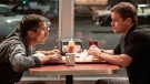 """This image released by 20th Century fox shows Christian Bale, left, and Matt Damon in a scene from """"Ford v. Ferrari,"""" in theaters on Nov. 15. (Merrick Morton/20th Century Fox via AP)"""