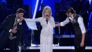 "Dolly Parton, centre, performs ""God Only Knows"", ""There Was Jesus"", and ""Faith"" with Joel Smallbone, left, and Luke Smallbone, right, of For King & Country at the 53rd annual CMA Awards at Bridgestone Arena, Wednesday, Nov. 13, 2019, in Nashville, Tenn. (AP Photo/Mark J. Terrill)"