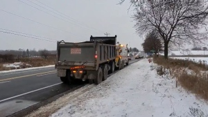 A dump truck is towed away in Caledon on Wed., Nov. 13, 2019 (OPP/Twitter)