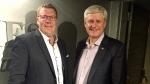 A photo of Sask. Premier Scott Moe and Stephen Harper shared on Twitter by the former prime minister in 2018.