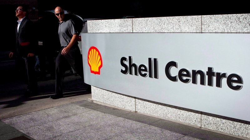 Pedestrians walk past Shell Canada's headquarters during a news conference in Calgary, Thursday, Aug. 26, 2010. (THE CANADIAN PRESS / Jeff McIntosh)