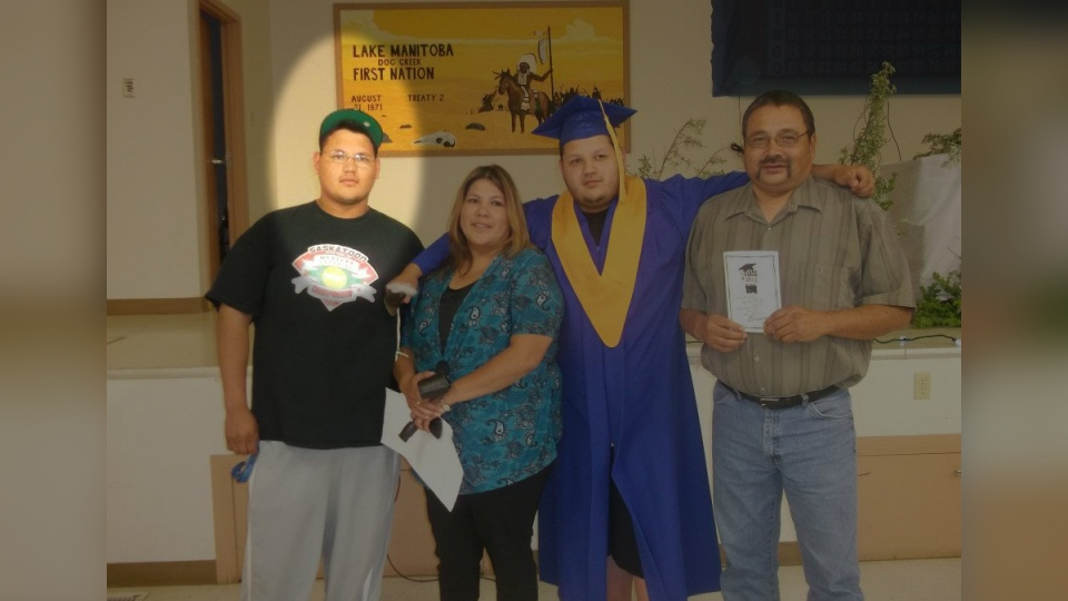 Todd Maytwayashing, left, with his parents and brother at his brother Avery's high school graduation. (Source: Barry Swan)