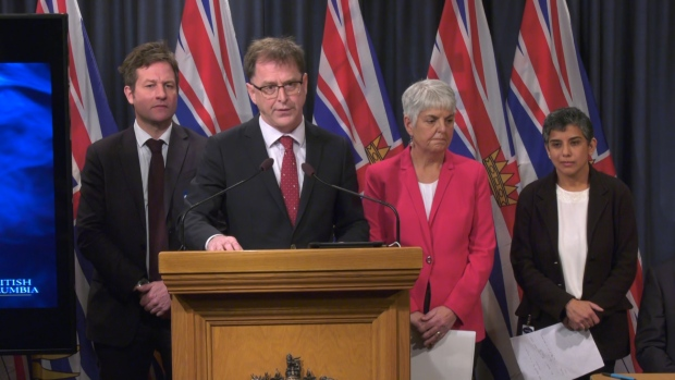 B.C. Health Minister Adrian Dix, second from left, speaks about the new regulations designed to curb vaping in the province, particularly among youths, on Nov. 14, 2019.