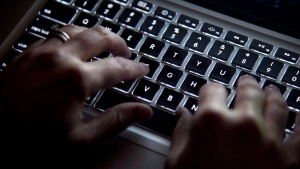 A woman uses her computer keyboard to type while surfing the internet in North Vancouver, B.C., on Wednesday, December, 19, 2012. THE CANADIAN PRESS/Jonathan Hayward