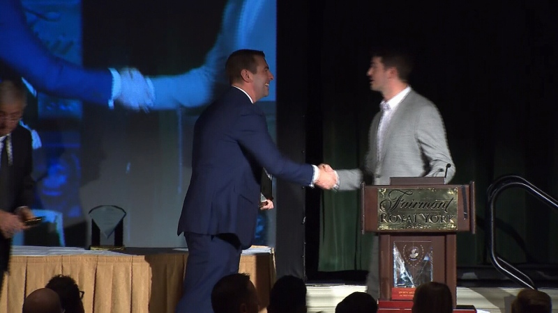 Jon Bartlett presented the award, and Randy's son Jesse Tieman accepted it.