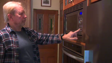 Gary Hofman spent nearly $1000 fixing his $400 microwave. (CTV News Toronto)
